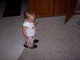 Mary standing in mommy's shoes.  Picture shot from above.