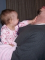Mary pushing on daddy's throat making him bend his head backwards.