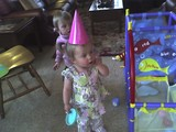 Mary standing in a party hat.