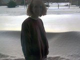 Sherri (aka. mommy) in front of a 3 foot snow drift that was against our garage door.
