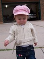 Mary in her pink waif hat and tan knitted sweater.